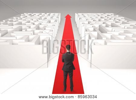 Successful businessman in front of a separated labyrinth, concept about simple solution
