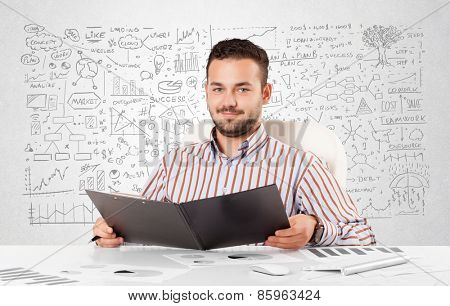 Young businessman planning and calculating with various business ideas