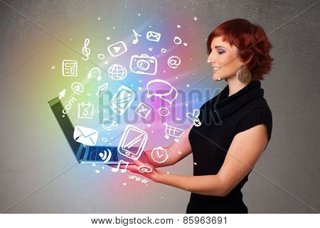 Beautiful young woman holding notebook with colorful hand drawn multimedia icons