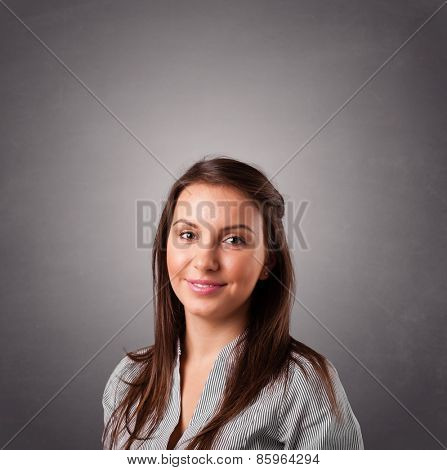 Beautiful young woman standing and thinking with copy space