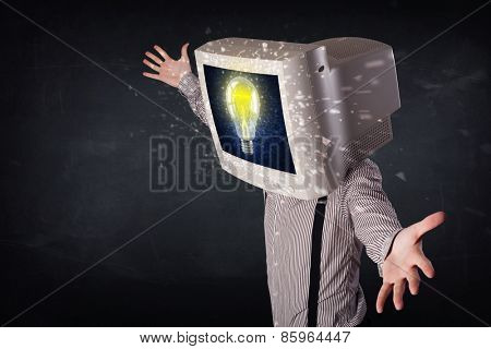 Business man with a pc monitor head and idea light bulb glowing in the display