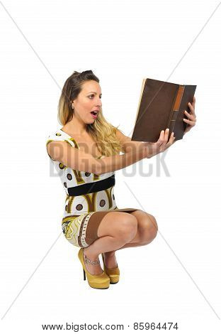 Young Sexy Attractive Woman Wearing Short Trendy Dress And High Heels Holding teacher Book