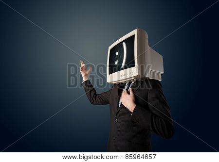 Funny young businessman with a monitor on his head and face on the black screen