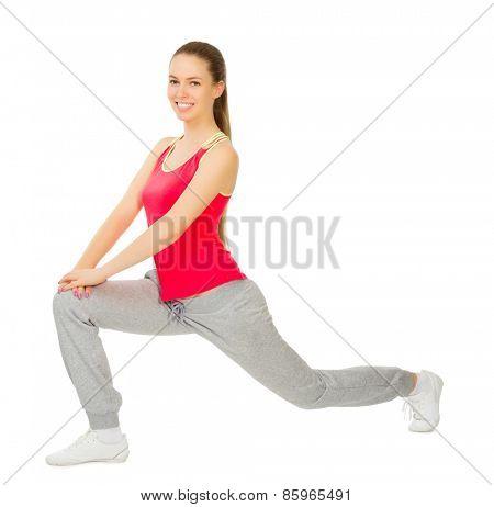 Young sporty girl doing gymnastic exercises isolated