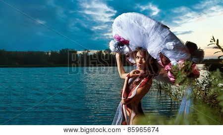 Beautiful Woman In Bodyart On The River Sunset  Background