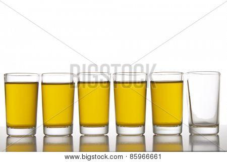 Six glasses, one empty