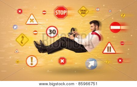 Young driver with road signs around him concept