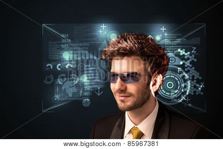 Young man looking with futuristic smart high tech glasses concept
