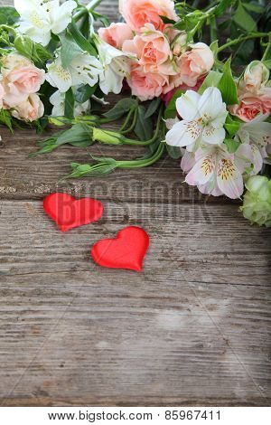 Bouquet Of Of Beautiful Flowers And Red Hearts