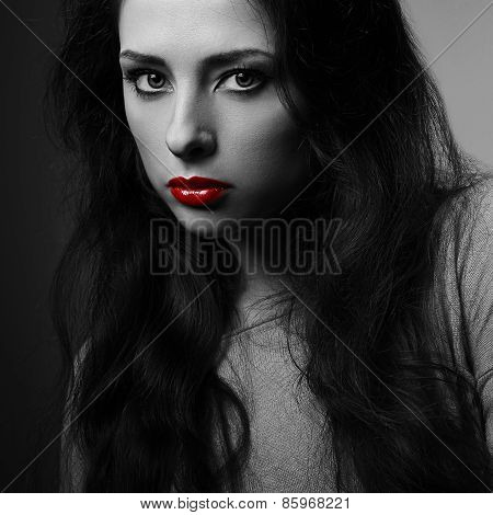 Sexy Makeup Woman With Red Lipstick Looking Mystery. Darkness