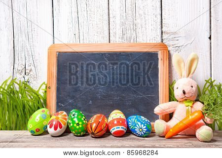 Easter decoration with sugar rabbits, eggs and message board