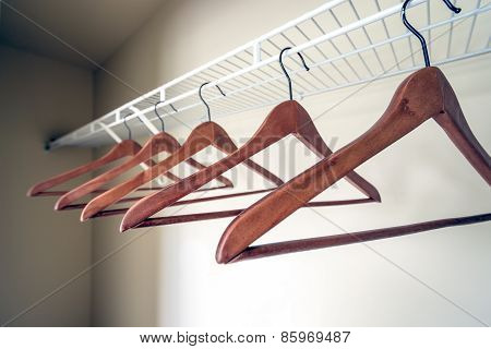 Closeup of coat hangers in an empty closet.