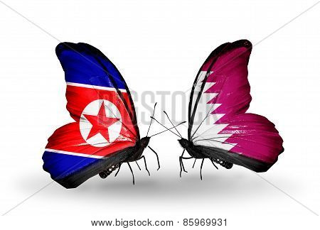 Two Butterflies With Flags On Wings As Symbol Of Relations North Korea And  Qatar