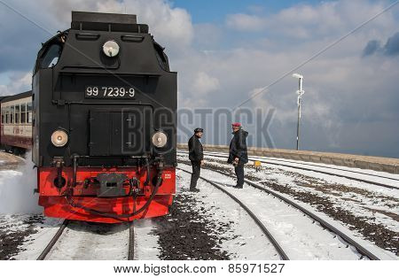 Locomotive Of The Harzer Schmalspurbahnen With Conductor And Machinist
