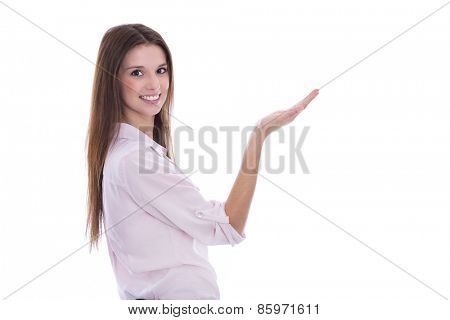 Presenting young business woman in pink blouse with palm. Isolated hand for product presentation.