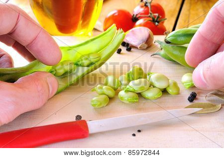 Chef Preparing Some Beans On A Cutting Board