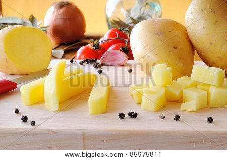 Potatoes On A Cutting Board Ready To Be Cooked