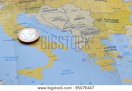 One Euro Coin On A  European Map