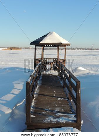 Wooden Gazebo By The River At Winter