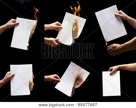 Man hand holding lighter and white burning papers with space for text