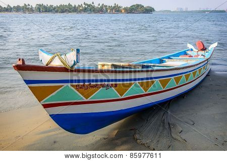 Landscape with traditional Indian boat