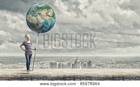 Cute little girl with Earth planet banner. Elements of this image are furnished by NASA