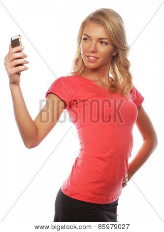 sporty blond woman making selfie, studio shot