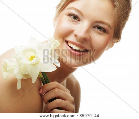 beautiful girl smiling and with flower narcissus