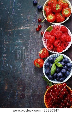 Fresh Berries on Wooden Background. Strawberries, Raspberries and Blueberries. Health, Diet, Gardening, Harvest Concept