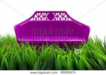 Isolated Red Sofa On Grass Field