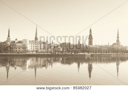 Sepia photo of Riga center and Daugava