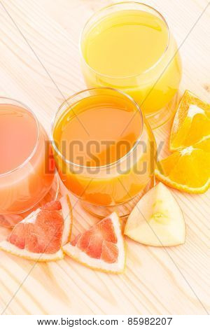 Vitamins Background. Fresh Fruits With Glass Of Juice Behind