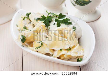 Italian tortellini pasta with cheese sauce and parsley
