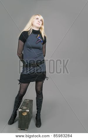 Pretty Sensual Caucasian Blond Female Posing With Suitcase. Against Gray