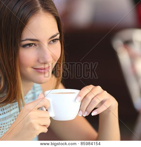 Pensive Woman Tasting Coffee In A Restaurant