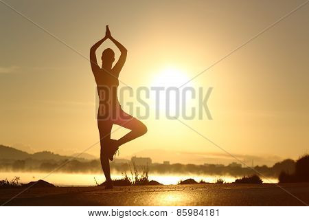 Silhouette Of A Fitness Woman Exercising Yoga Meditation Exercise