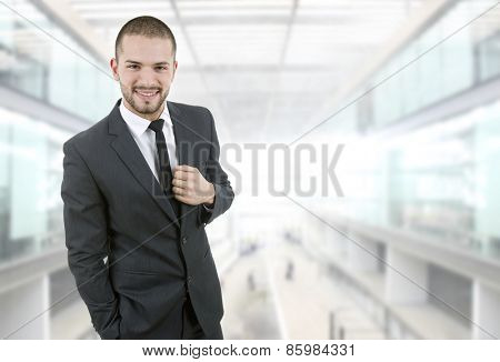 happy young businessman portrait at the office