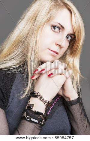 Portrait Of Beautiful Caucasian Blond Female. Isolated Over Gray Background