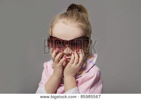 Portrait Of Cute Little Caucasian Girl In Sunglasses