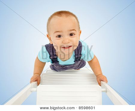 Little Boy Walking On Ladder