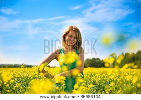 blond woman in a rape field.