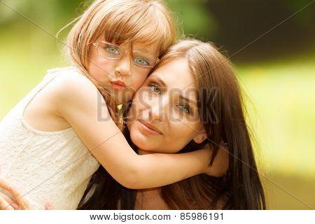 Little Girl Hugging His Mother Expressing Tender Feelings. Love.