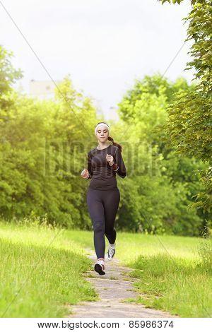Sports Concept: Positive Sensual Caucasian Sportswoman Running Fast