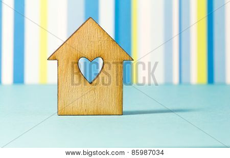 Wooden House With Hole In The Form Of Heart On Blue Striped Background
