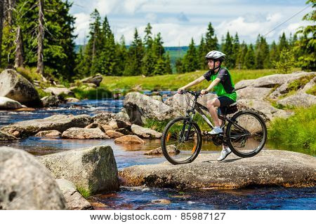 Healthy lifestyle - teenage boy biking