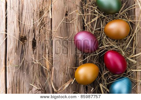 Easter eggs on wooden background, close-up.