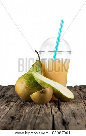 Fresh healthy pear juice, healthy drink on wooden table.
