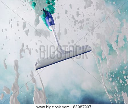 Cleaning windows with a squeegee
