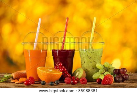 Fresh juice mix fruit, healthy drinks on wooden table.