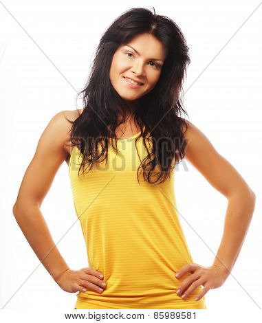 Young happy woman in sports wear